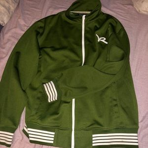 Rica wear green og zip up track sweater